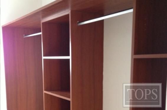 Closets de madera y melamina tops s a nicaragua for Disenos de closets sencillos